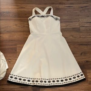 White dress with black accent on neckline